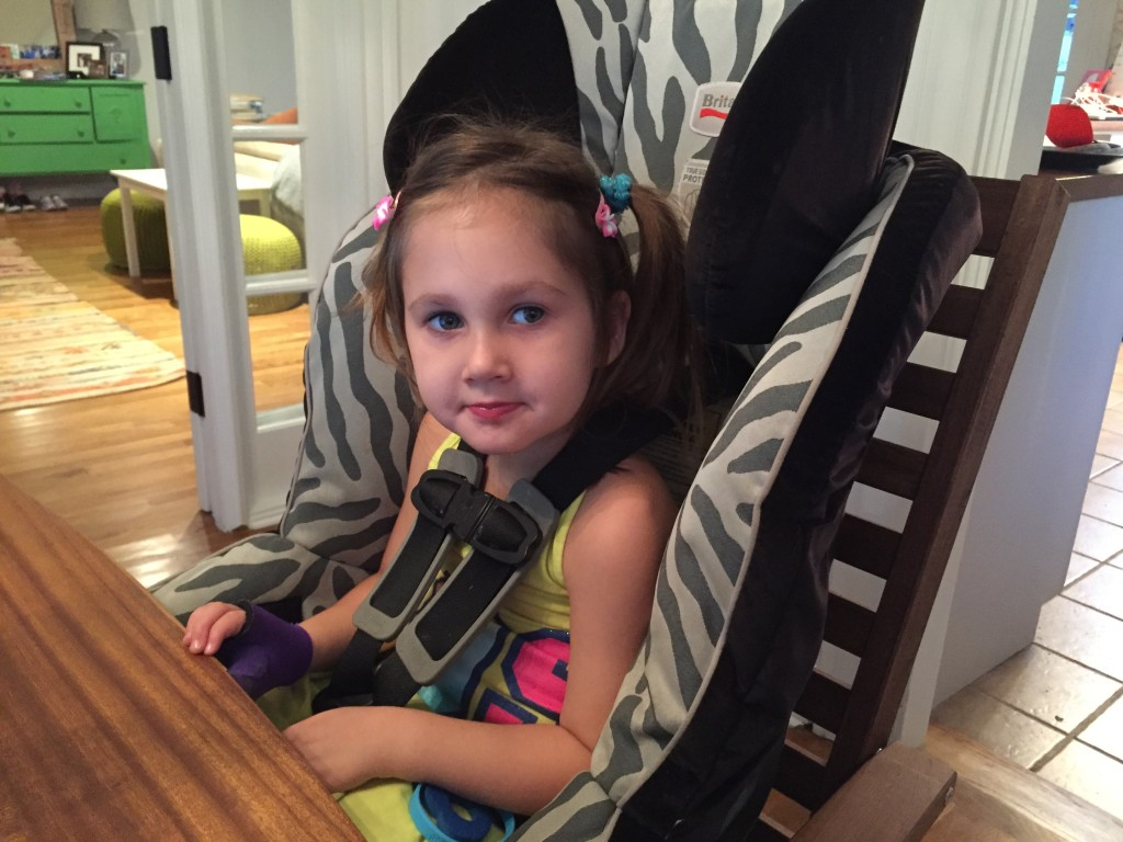 Maggie in car seat at table